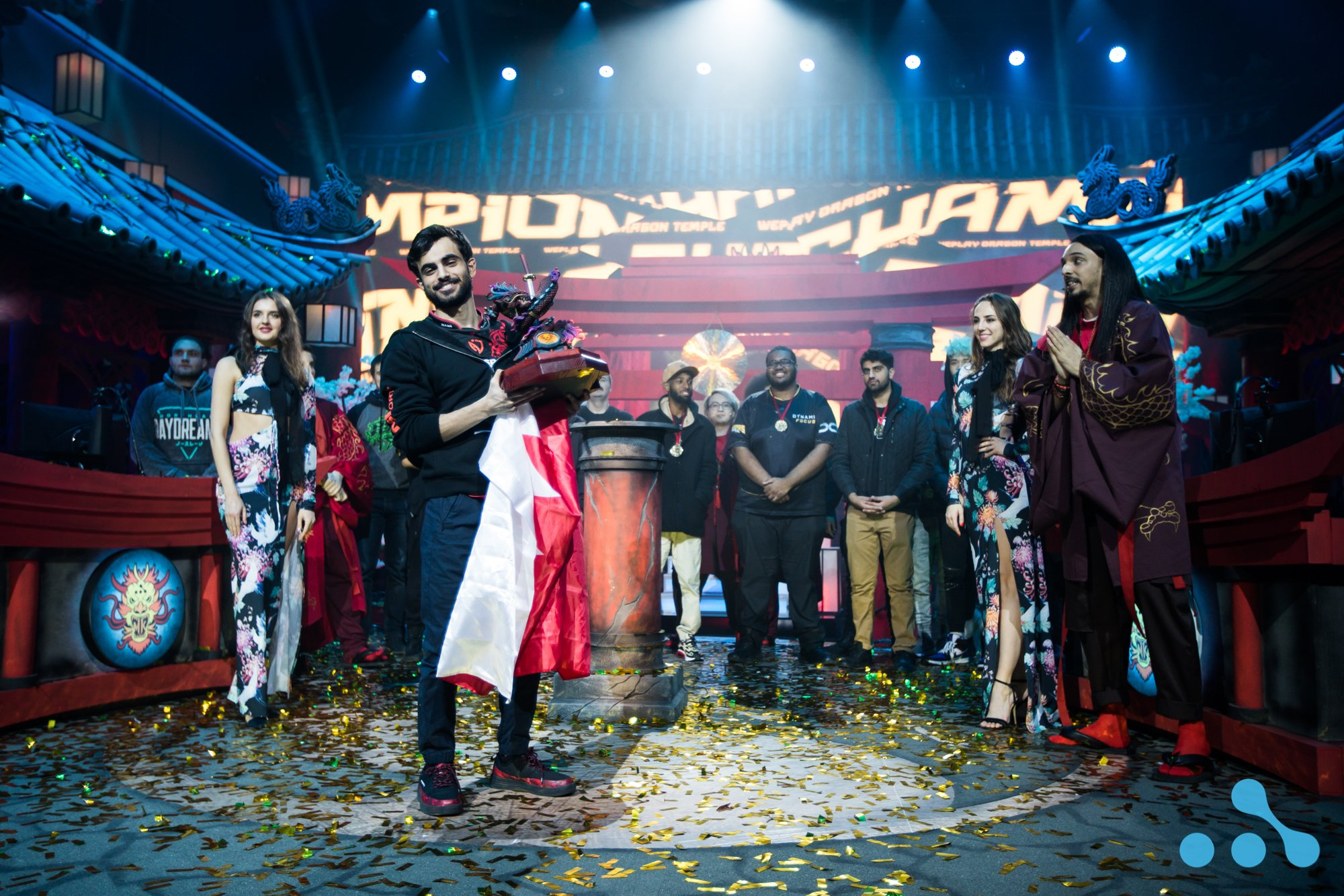 WePlay Dragon Temple champion Tekken Master holding the trophy. Photo credit: WePlay Esports